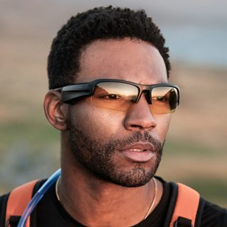 Man hiking wearing Bose Frames Tempo with Twilight Yellow lenses