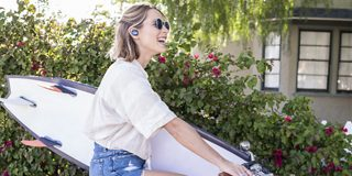 Woman wearing SoundSport Free wireless headphones