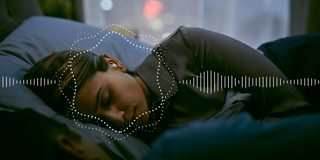 Woman sleeping with Bose noise-masking sleepbuds