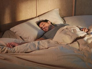 Man sleeping with Bose Sleepbuds II