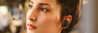Woman wearing Triple Black Bose QuietComfort Earbuds