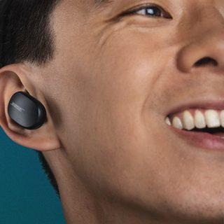 Man wearing Soapstone Bose QuietComfort Earbuds