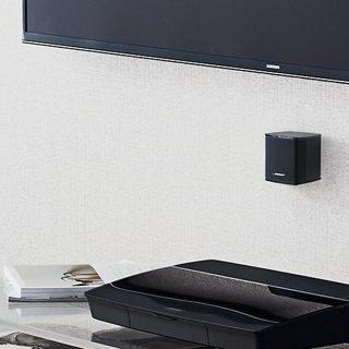 Vægmonterede Virtually Invisible højttalere og betjeningskonsol