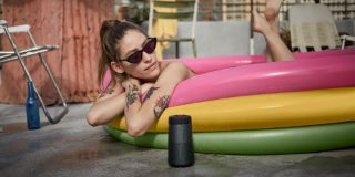 SoundLink Revolve Bluetooth speaker outside near an inflatable pool