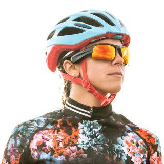 Woman biker wearing Bose Frames Tempo with Road Orange Lenses